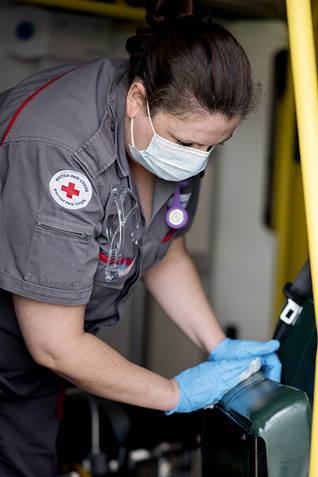 Carrie cleans one of the ambulances used by our ambulance support team