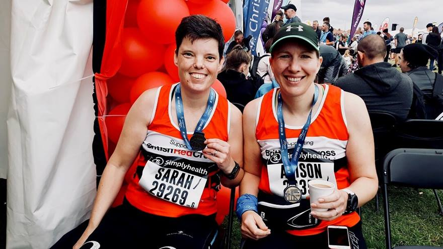 Two  women with their medals after completing the Great North Run