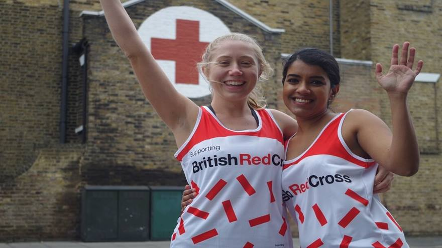 Two runners cheering outside the Hackney Refugee centre