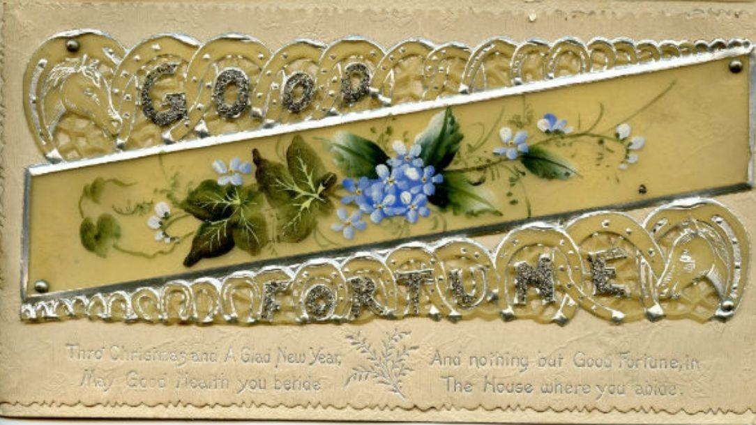 A Christmas card with violet flowers in the middle and the phrase 'Good fortune' on the outer edges, handmade by Florence Nightingale.
