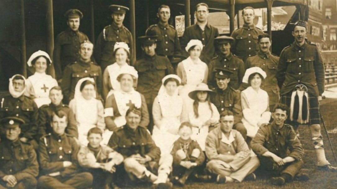 British Red Cross volunteers and injured servicemen at Trent Bridge auxiliary hospital, First World War
