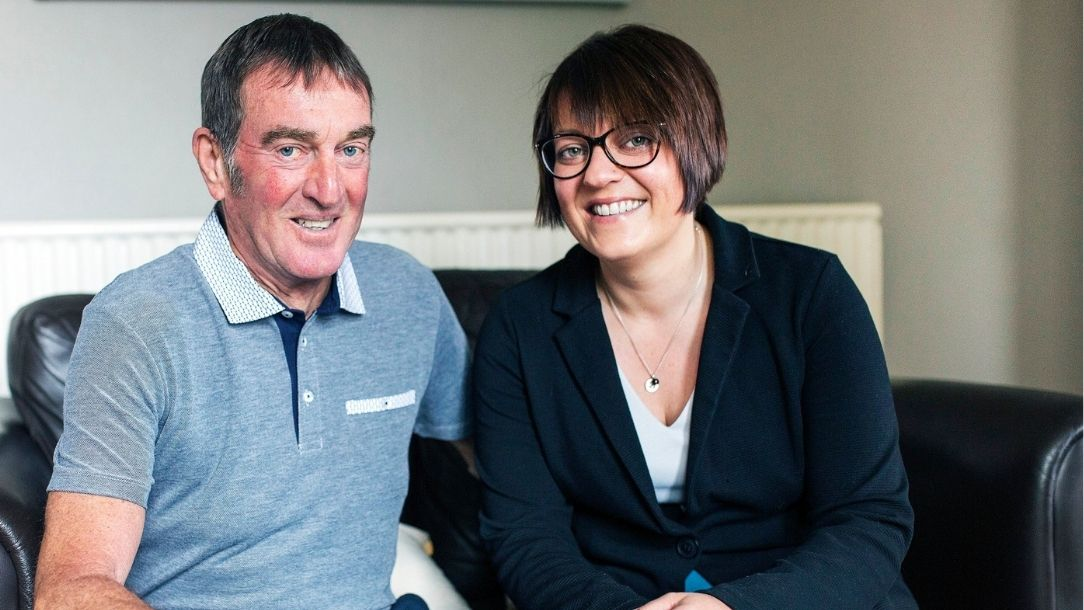 Zoe Tootle sits with her dad, who she saved from a heart attack thanks to British Red Cross advice.