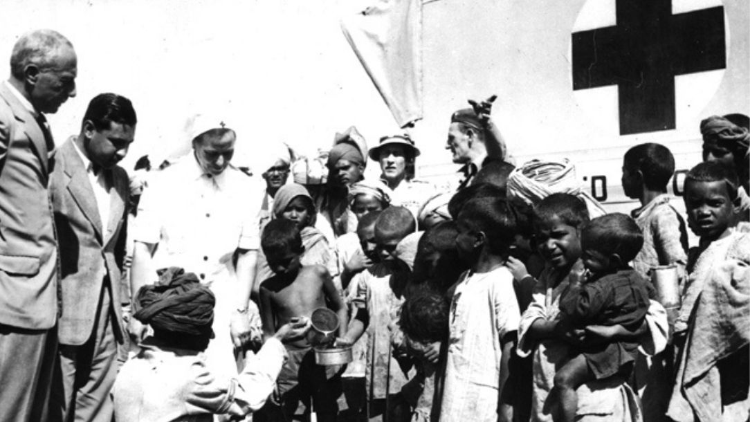 A black and white photograph showing the Red Cross distributing milk during the partition in Multan, Pakistan
