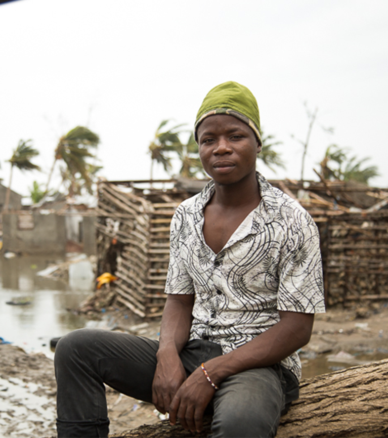 Man sitting down after Cyclone Idai hit Mozambique.