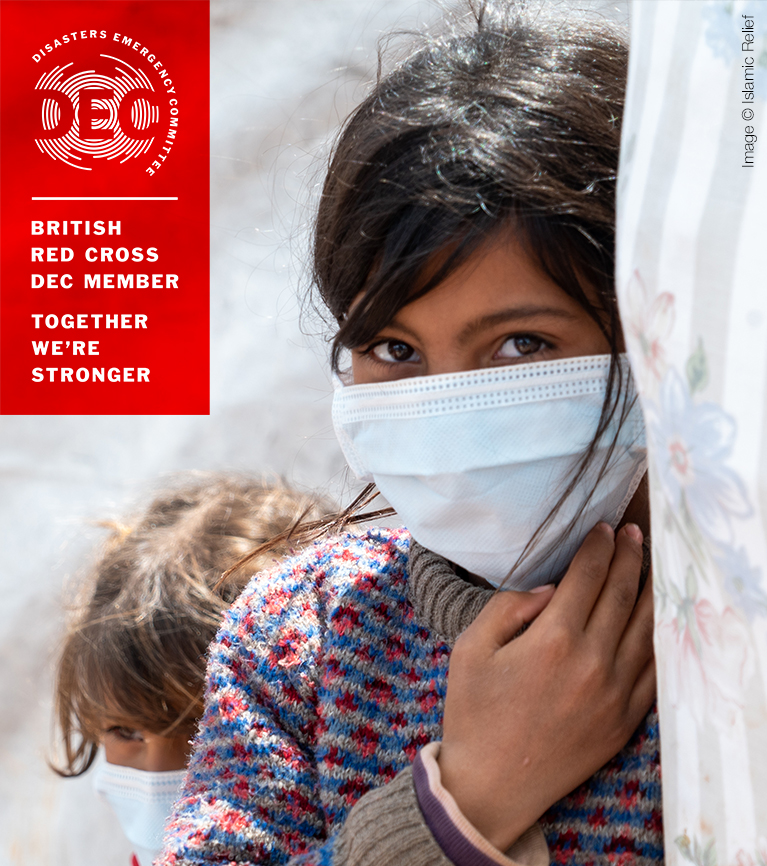 A young girl wearing a mask for protection against coronavirus looks out from inside a tent. A logo on the image reads: Disasters Emergency Committee - British Red Cross DEC Member - Together We're Stronger.