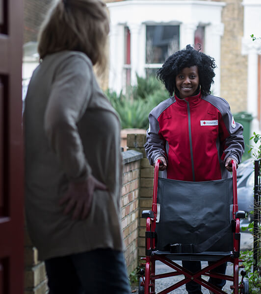 British Red Cross volunteer delivers a wheelchair