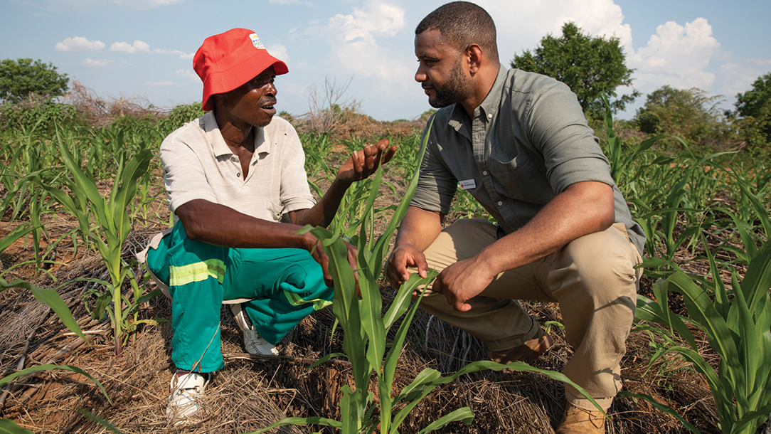 JB Gill with Red Cross volunteer and lead farmer Tadios Chikuko