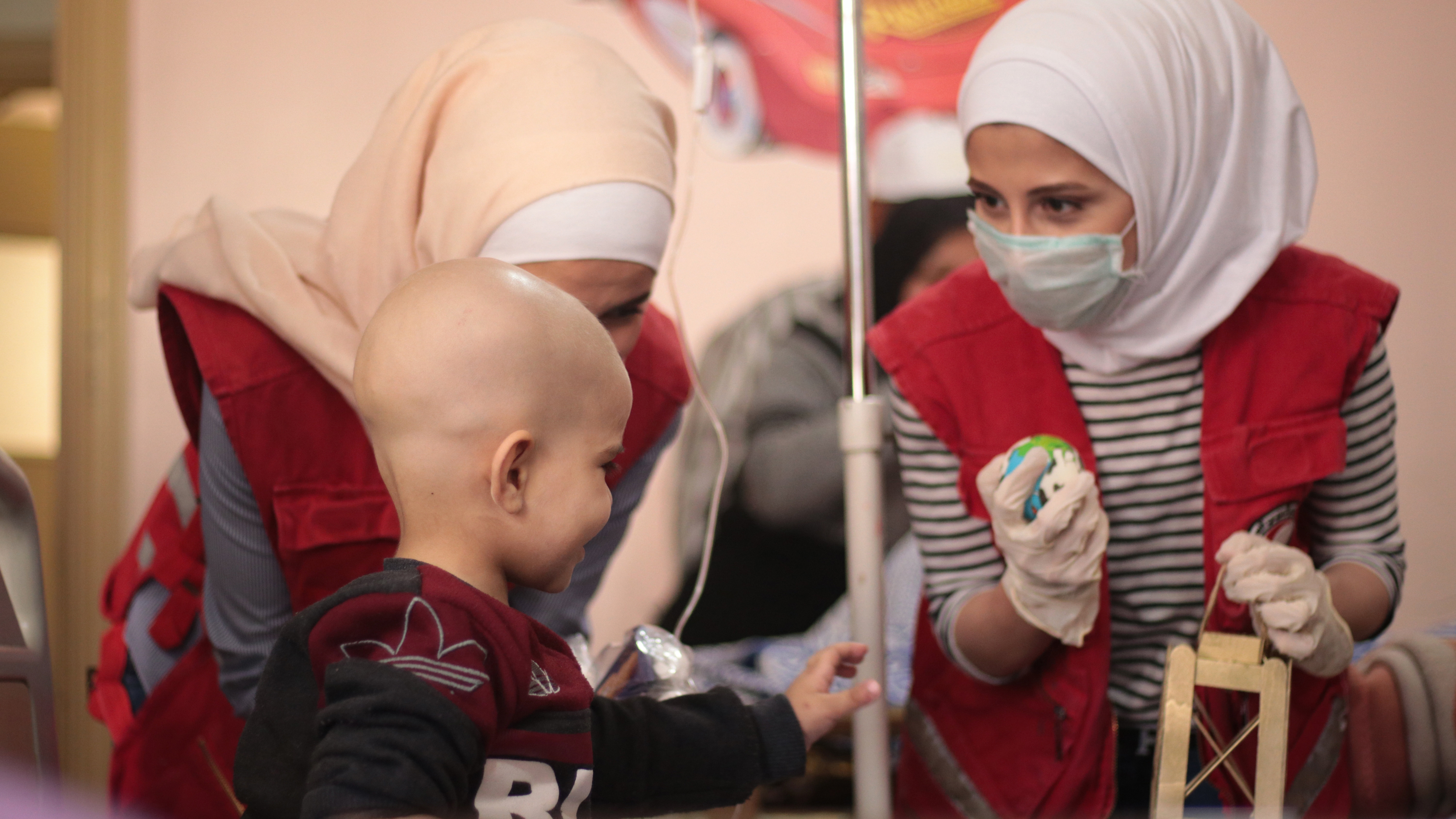 Volunteers provide support to children at Aleppo University Hospital