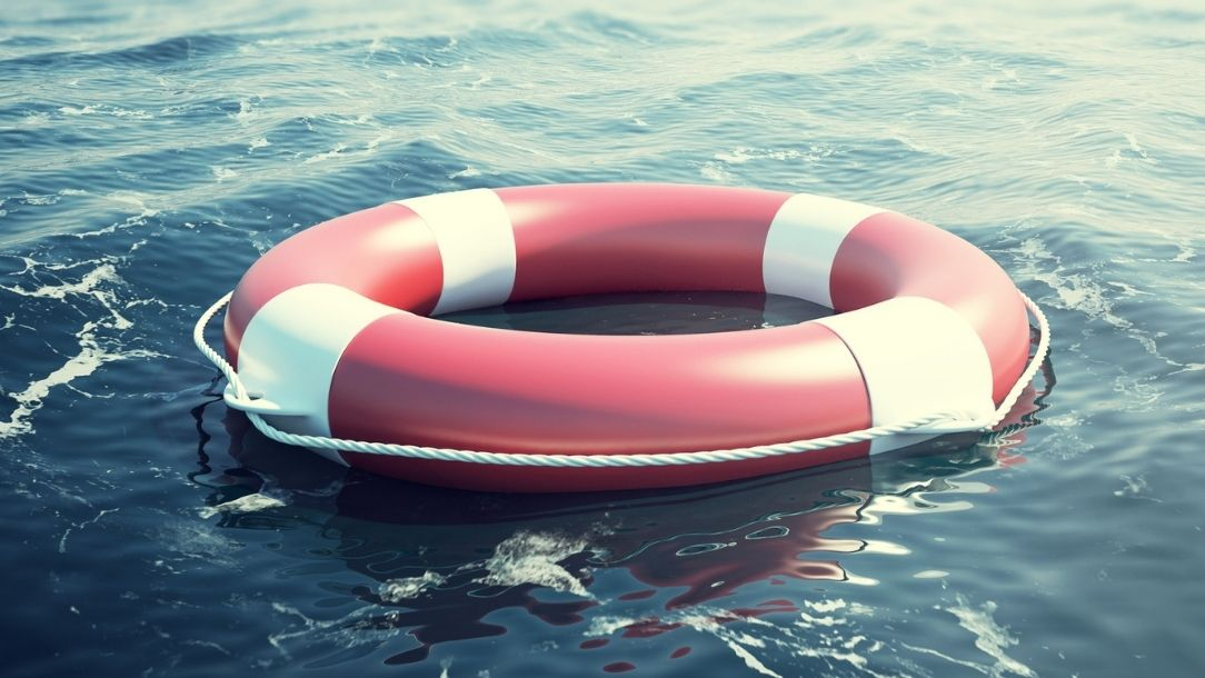 A red lifebuoy floating in open water from a British Red Cross blog about drowning in open water