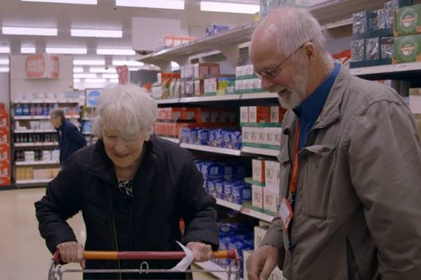 John-Cooper-helps-a-woman-in-a-supermarket